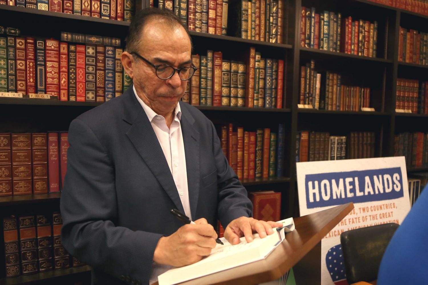 Corchado personalized some books for the attendees at the book signing at the Literarity Book on Wednesday, June 6.