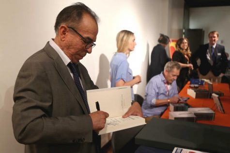 "Mexico border correspondent for the Dallas Morning News Alfredo Corchado signs his newest book ""Homelands: Four Friends, Two Countries, and the Fate of the Great Mexican-American Migration"" before the panel discussion on Thursday, June 7 at the Union."