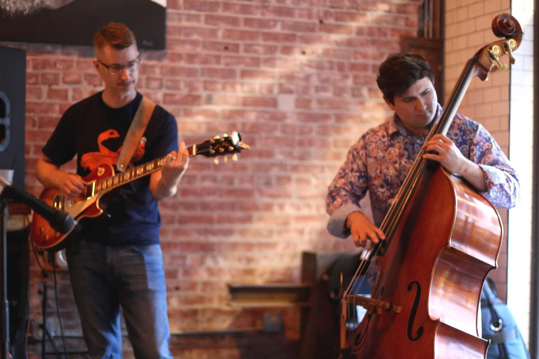 Shaun+Mahoney+play+the+guitar+while+Christian+Chesanek+plays+the+bass+for+The+Eddie+Provencio+Jazz+Band.