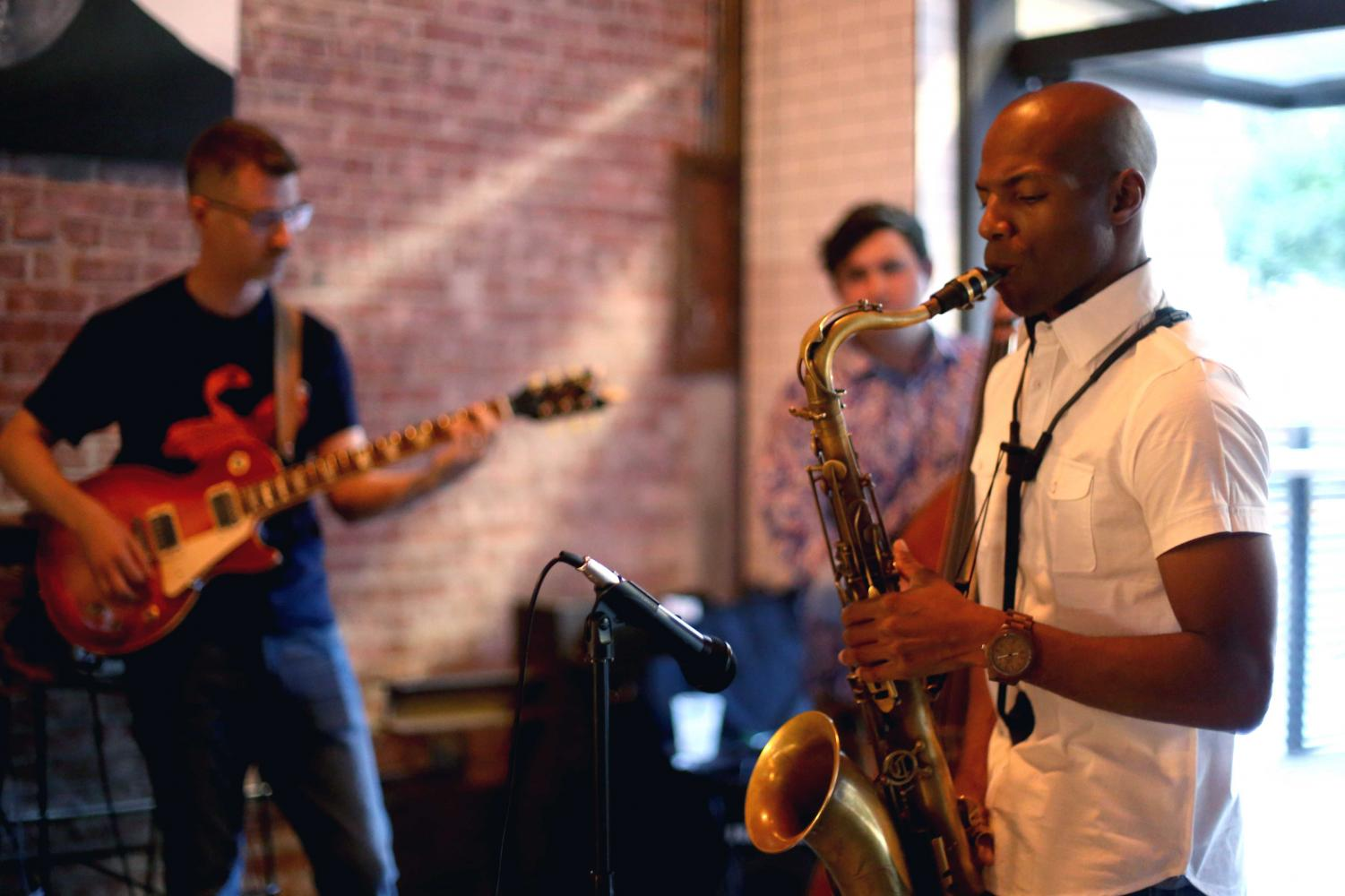 Ben+Newsome+plays+the+sax+for+The+Eddie+Provencio+Jazz+Band.
