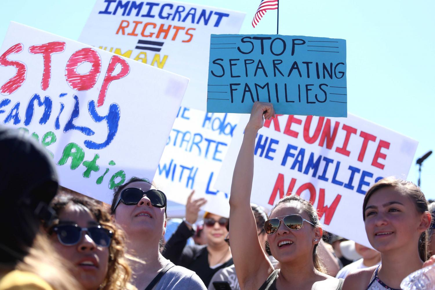 Hundreds march to demand an end to family separation at the