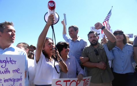 Congressman Beto O'Rourke and his supporters lock arms and march to the Tornillo Port of Entry on Sunday, June 17.