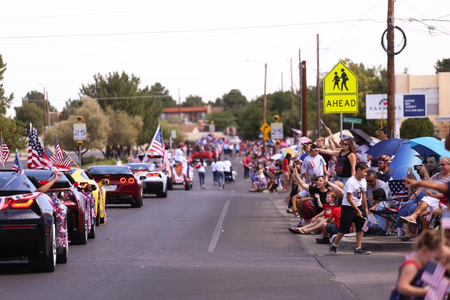 The community lines up along the sidewalk in Eastside El Paso for the 38th annual People's Parade on Wednesday, July 4th.