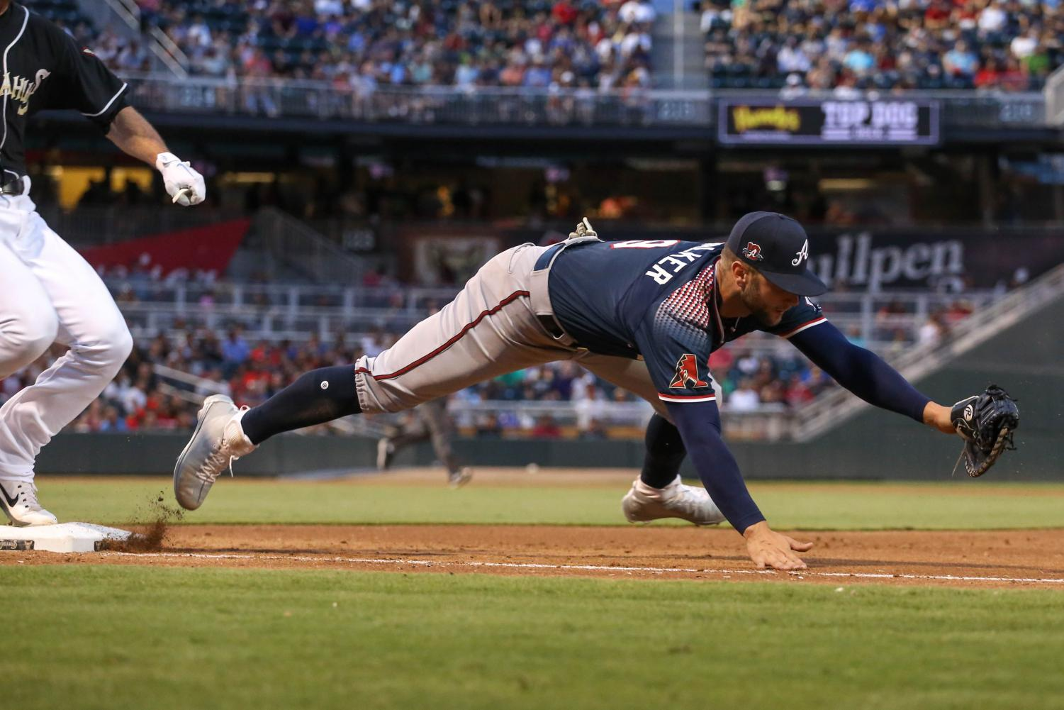 Reno+Aces+first+basemen+Christian+Walker+stretches+out+to+catch+the+ball+but+drops+it.