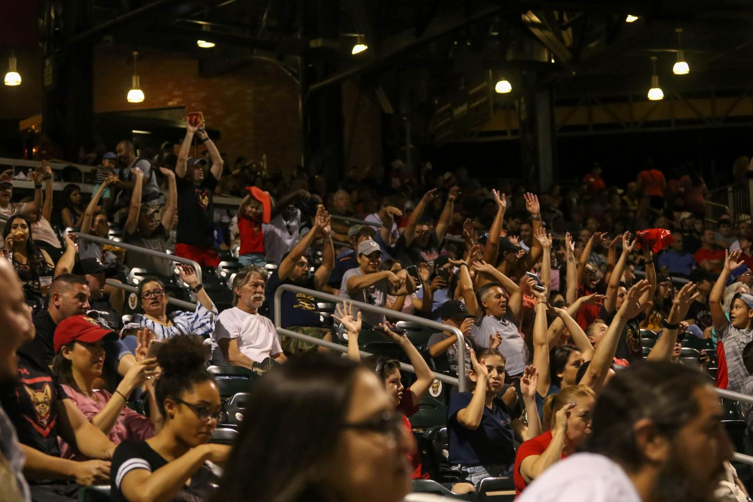The+crowd+does+the+wave+at+the+top+of+the+fourth+inning.+