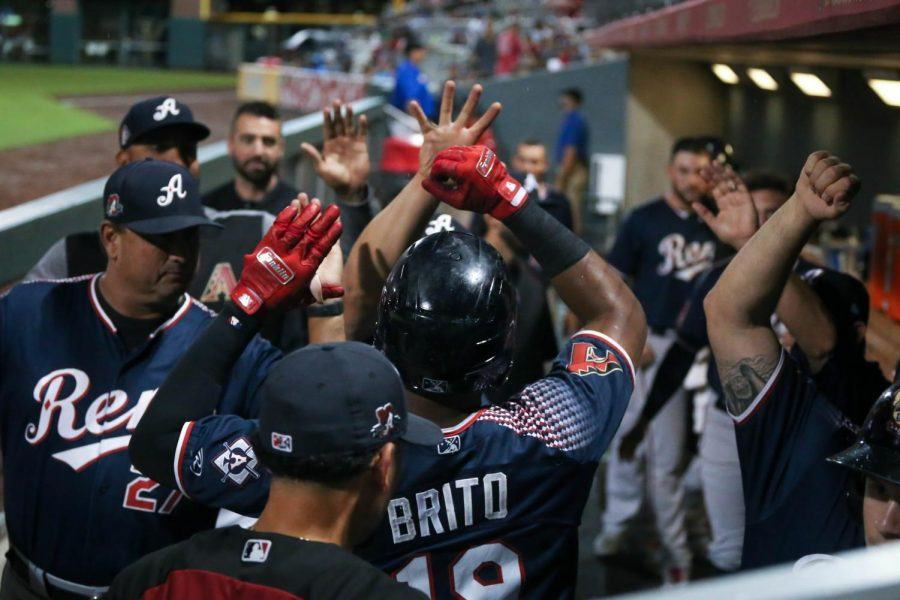 The Reno Aces celebrate as right fielder Socrates Brito scores a run
