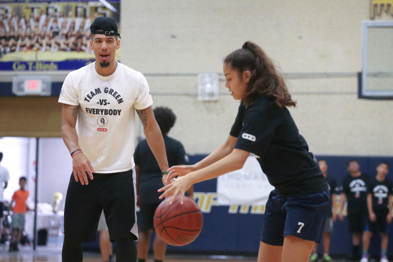 San Antonio Spurs guard/forward Danny Green works on some drills with the kids at his annual Skills Clinic on Saturday, July 7 at Coronado High School.