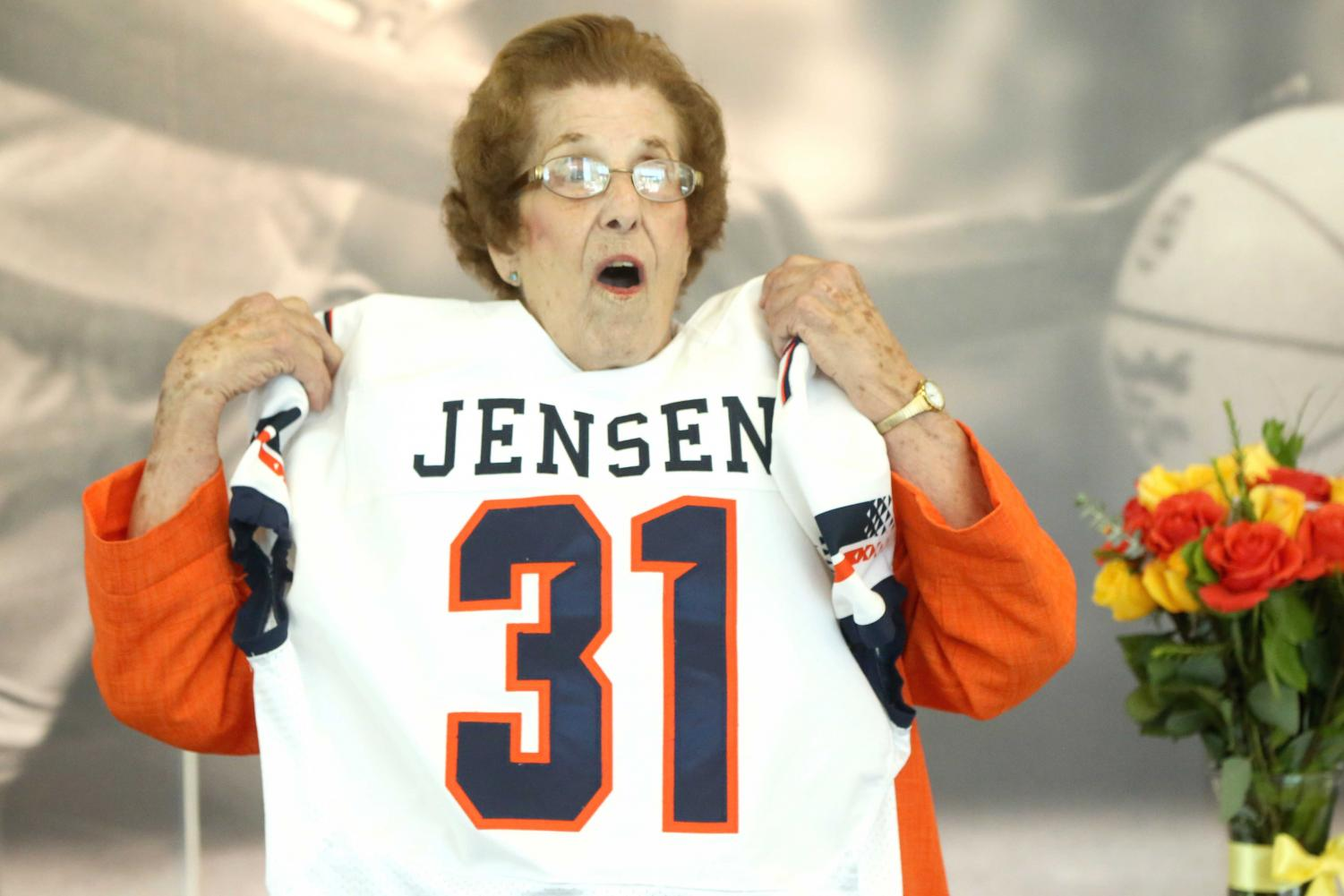 Katie Jensen reacts to the custom-made football jersey that Athletic Director Jim Senter gave her.