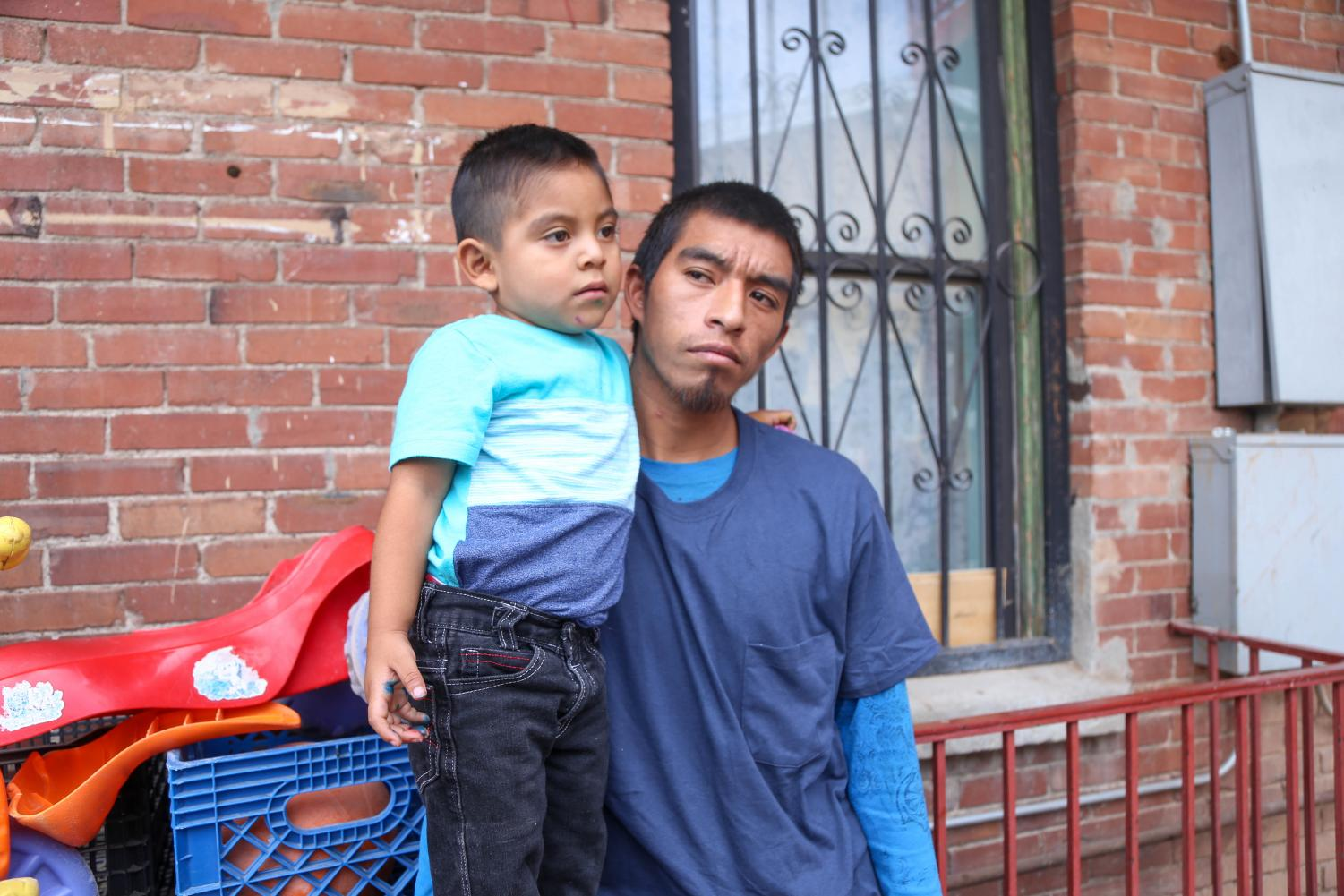 Pablo+and+his+son+Andre+pose+for+a+photo+outside+the+Annunciation+House+on+Wednesday%2C+July+11.+