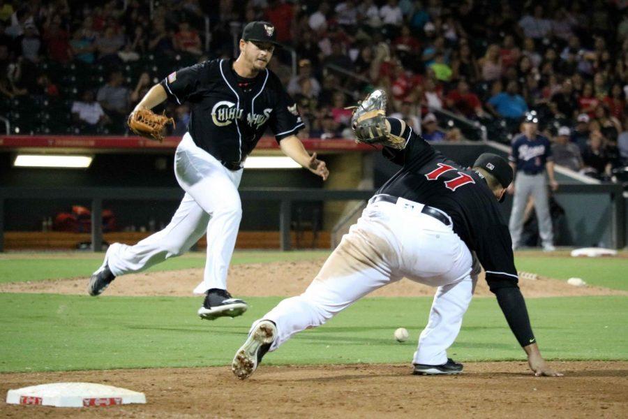 First+basemen+Allen+Craig+runs+after+the+ball+to+attempt+to+make+a+defensive+play.