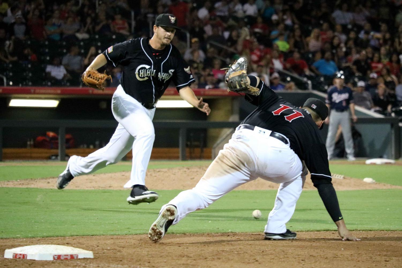 First basemen Allen Craig runs after the ball to attempt to make a defensive play.