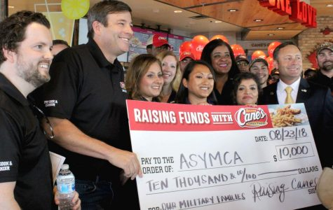 Raising Cane's supports the community by awarding Army Services YMCA with a $10,000 check.
