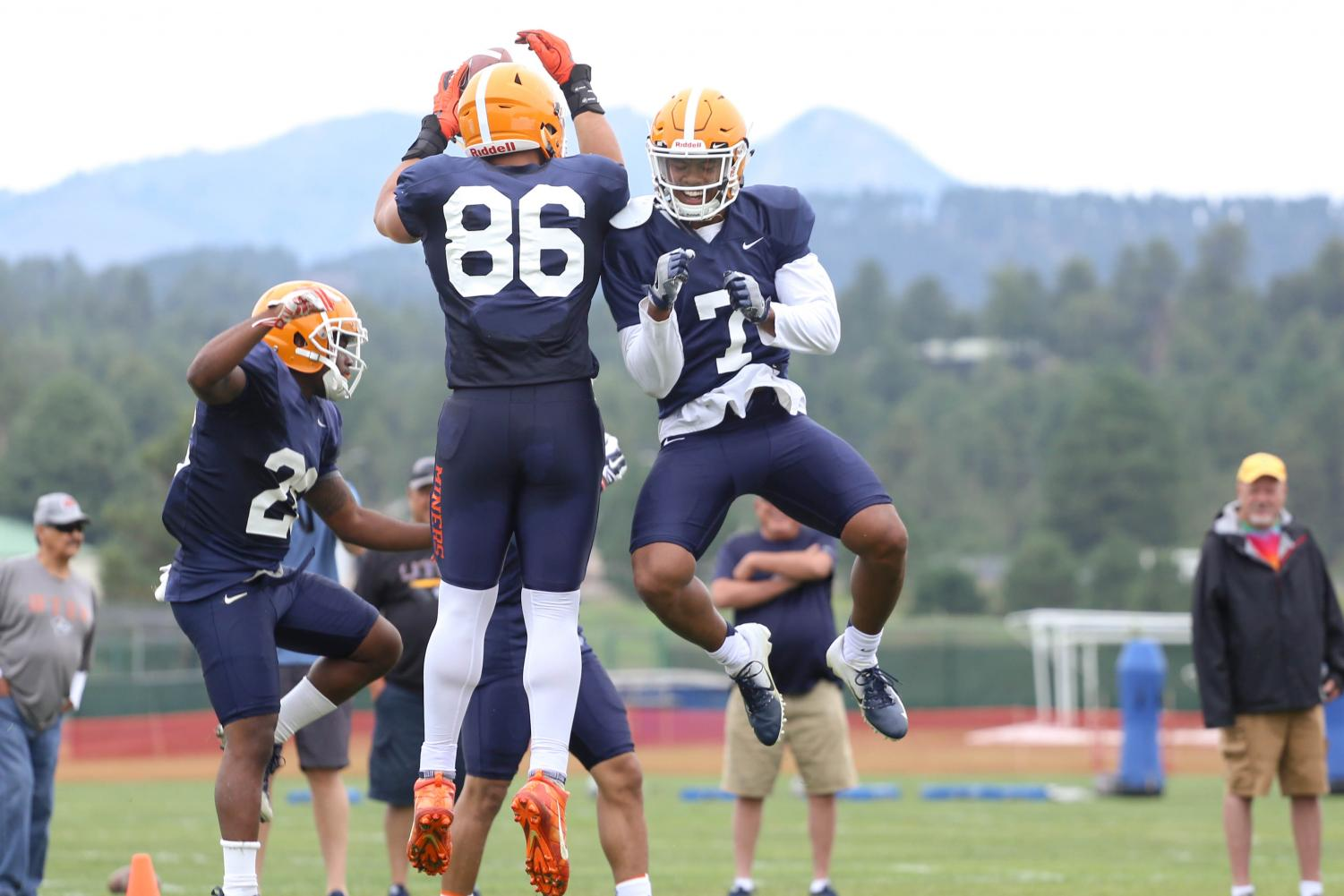 Tight+end+Josh+Weeks+and+wide+receiver+Kavika+Johnson+celebrate+after+Weeks+makes+the+catch.