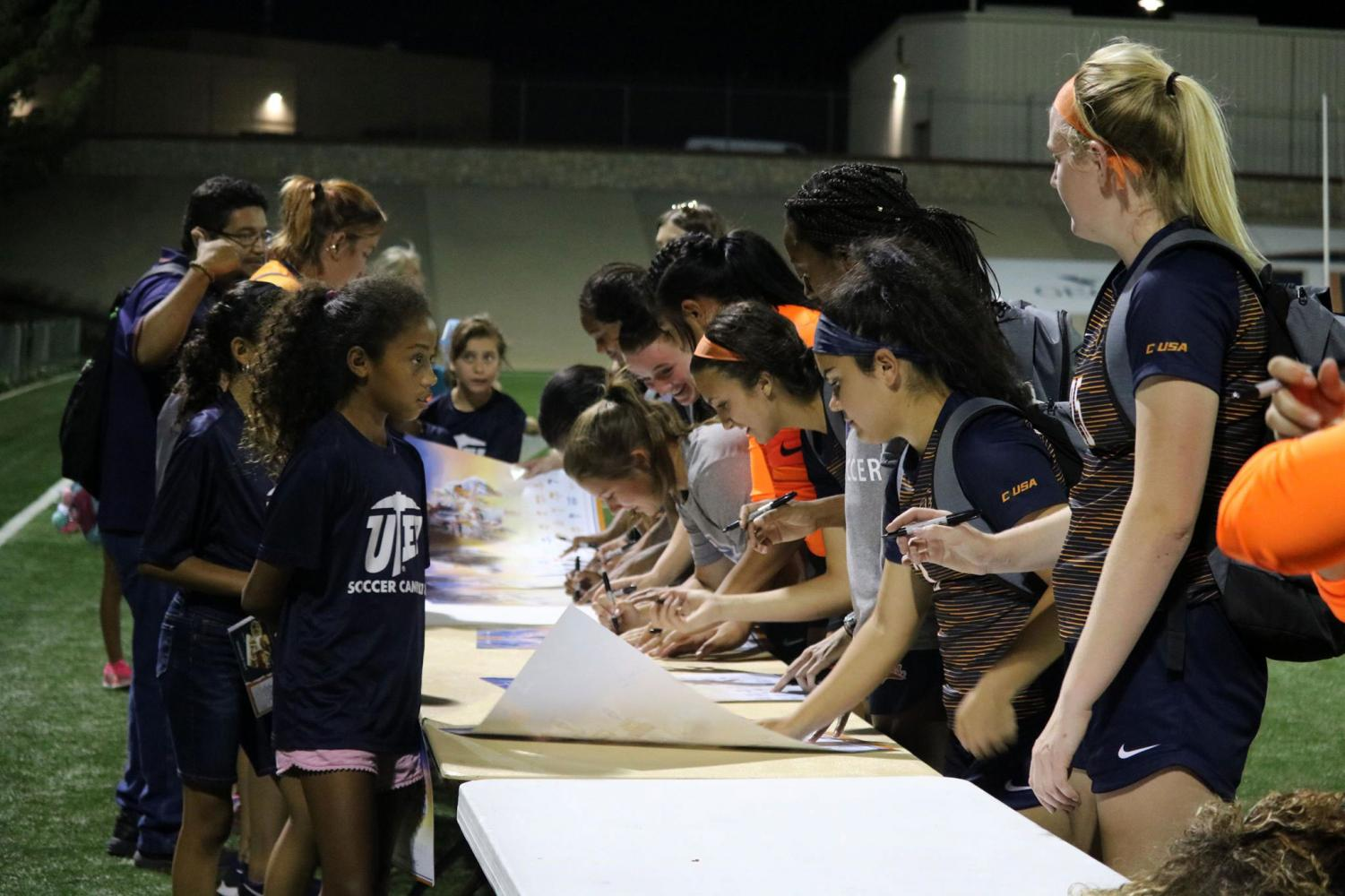 UTEP+Miners+%E2%80%8Bsign+autographs+to+the+soccer+girls+camp+at+the+University+field+on+August+17%2C+2018.
