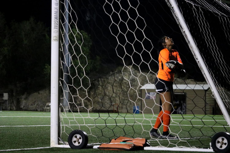 Goalkeeper Senior Alyssa Palacios prays before penalty.