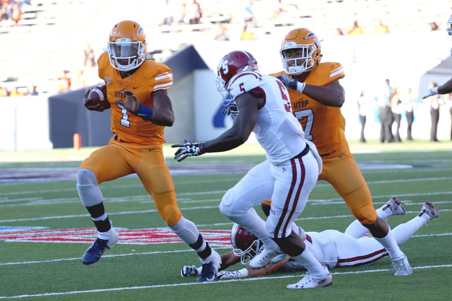 Senior quarterback Kai Locksley was arrested Saturday on four charges and is suspended from the team.