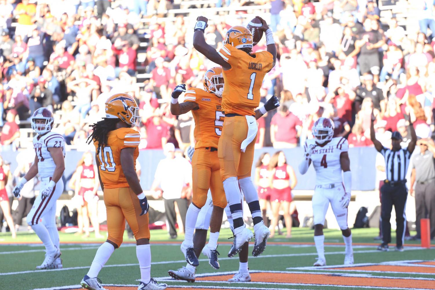 Junior+wide+receiver+Keynan+Foster+and+junior+Quarterback+Kai+Locksley+celebrate+as+UTEP+tied+the+game+at+seven.+