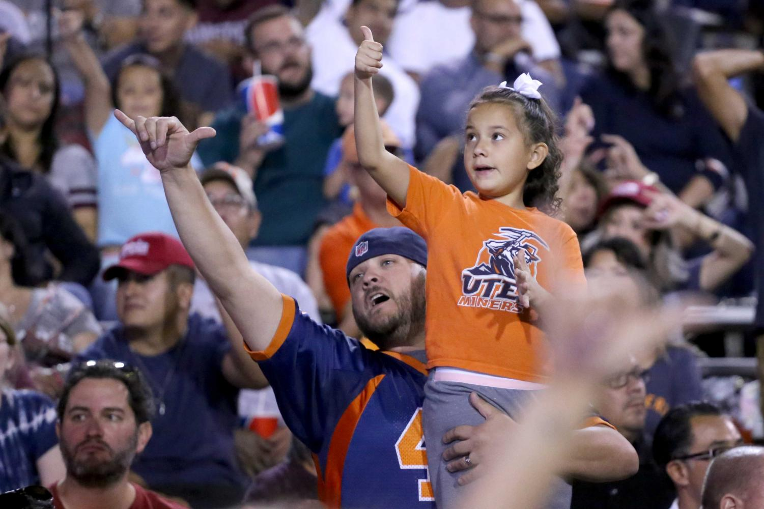 Fans+celebrate+with+the+UTEP+cheerleaders+as+they+throw+up+their+picks+up.