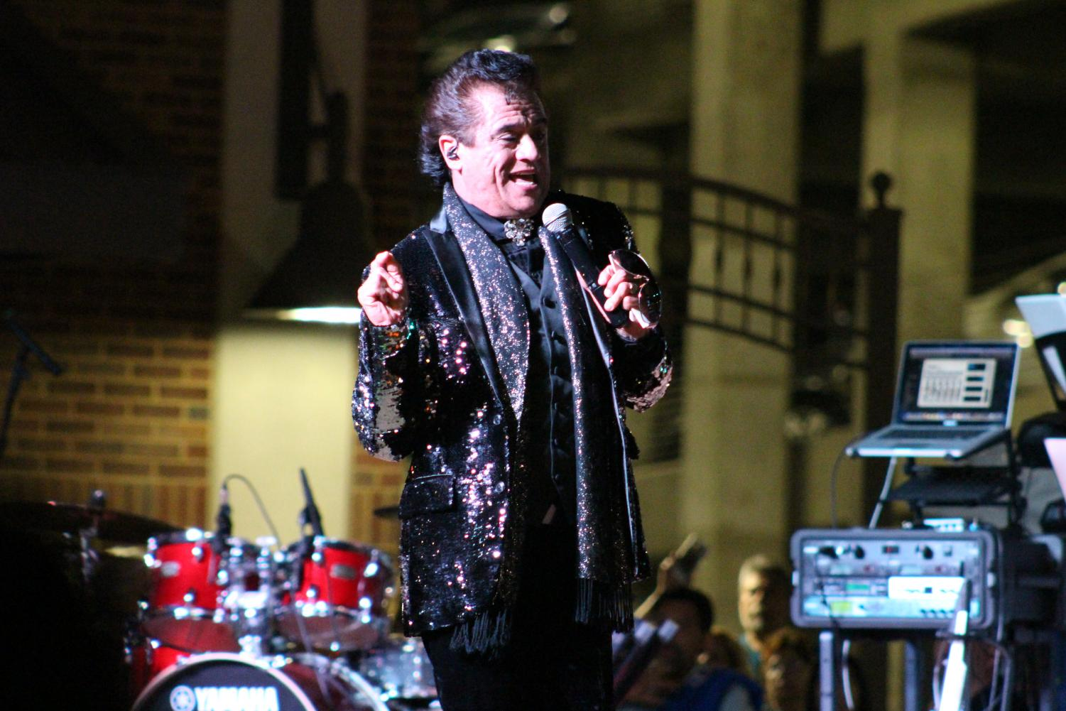 Hugo Cortes interprets Juan Gabriel at the tribute event at San Jacinto Plaza.