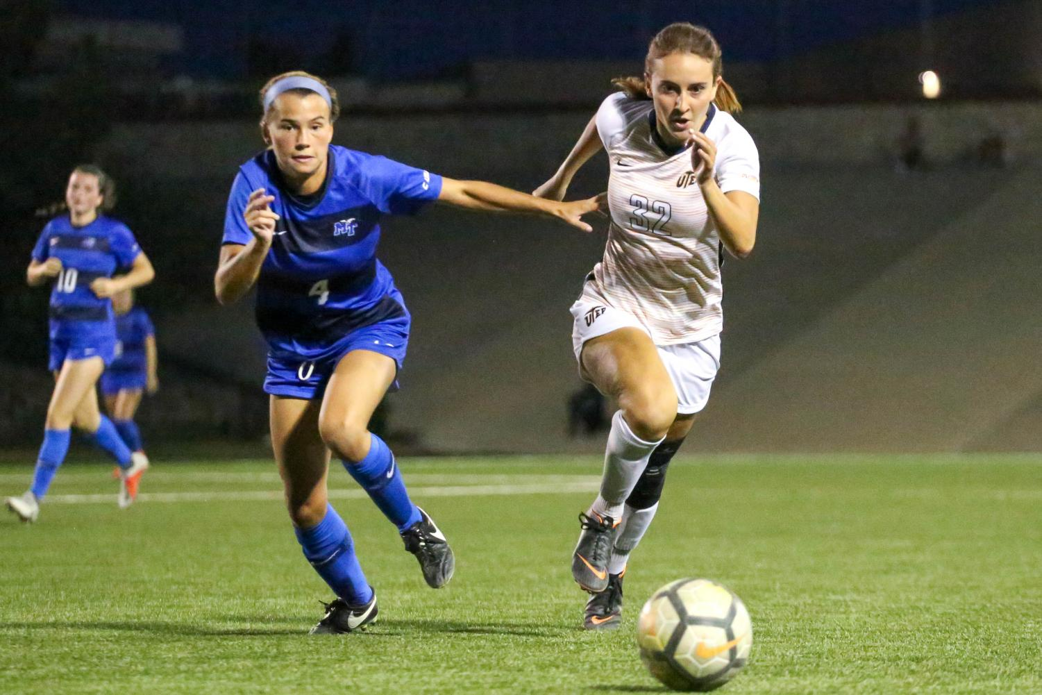 Sophomore midfielder April Pate and Middle Tennessee junior defender Casey River chase after a lose ball.