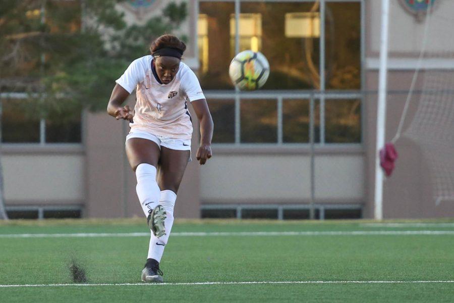 Redshirt sophomore defender Cayla Payne kicks the ball back towardsMiddle Tennesse's goal net.