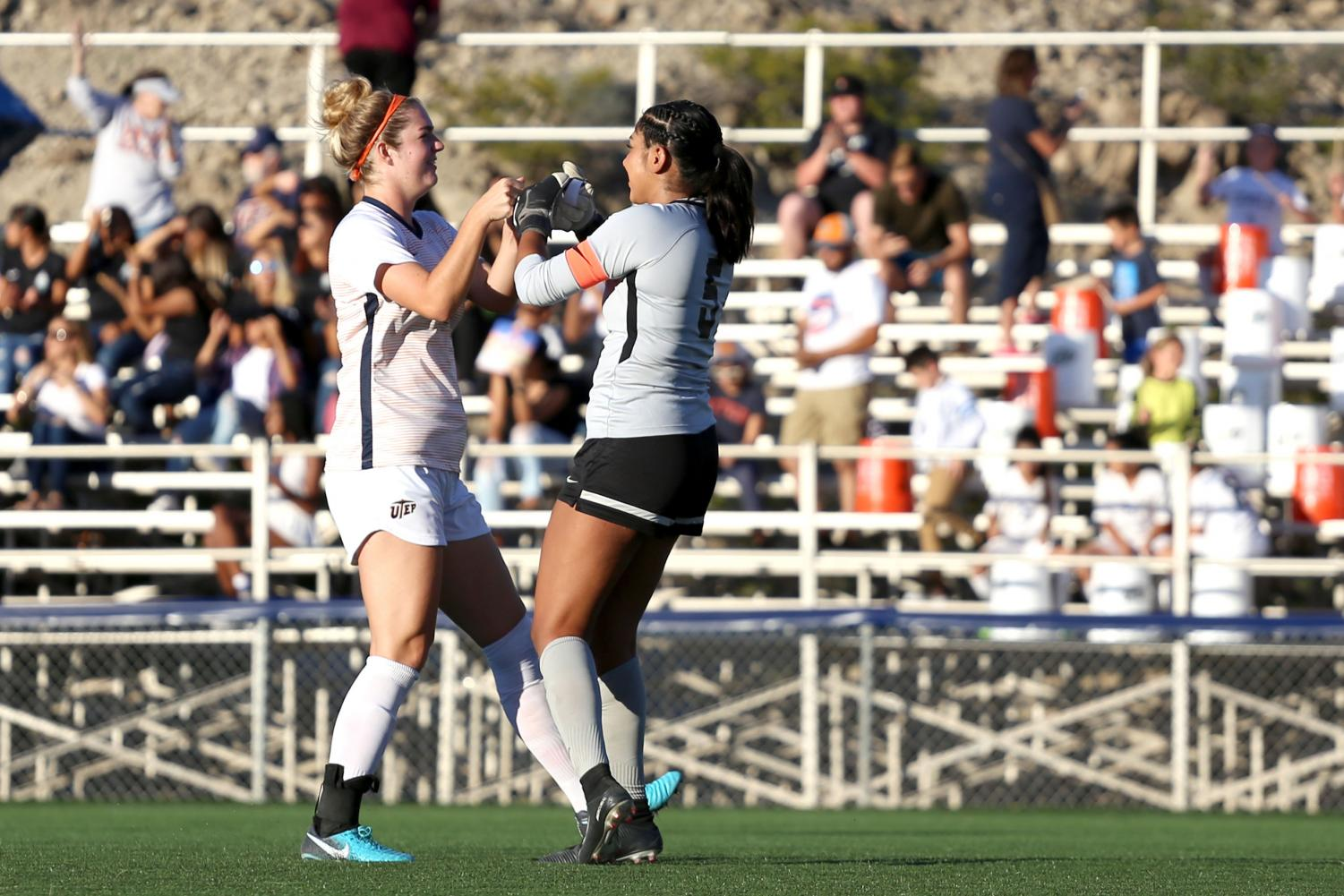 Senior goalkeeper Alyssa Palacios and senior defender Payton Ross celebrate as the miners score a second goal against NMSU.