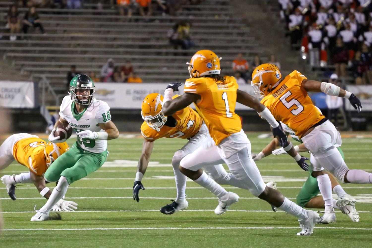 UNT+redshirt+sophomore+wide+receiver+Keegan+Brewer+attempts+to+make+the+play+against+the+UTEP+defenders.+