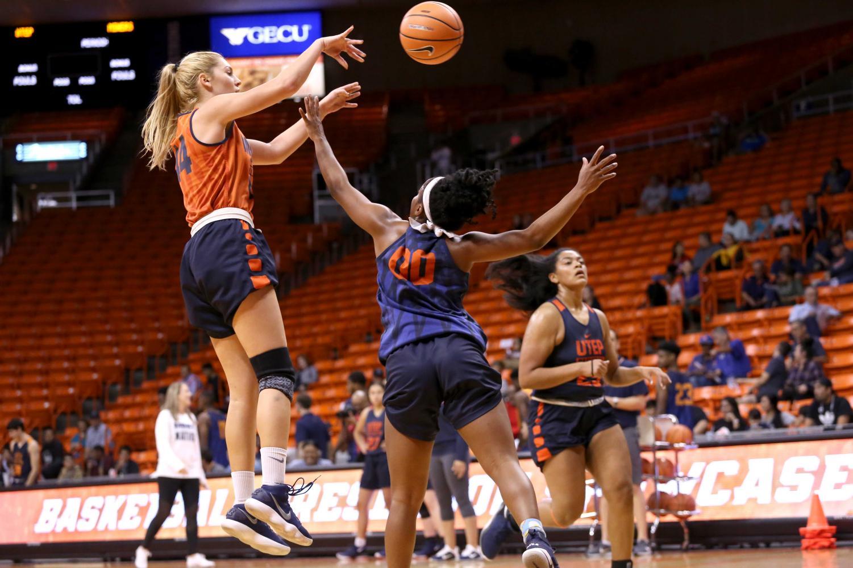 Junior guard Katarina Zec jumps to shoot the ball over sophomore point guard Jordan Jenkins.