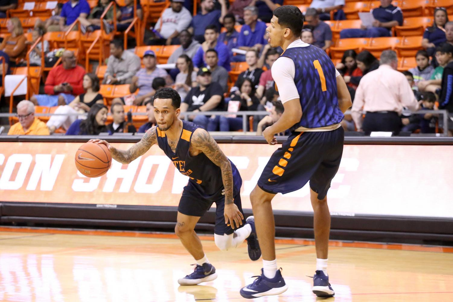 Sophomore guard Kobe Magee works on drills with senior Paul Thomas during the basketball pre season showcase at the Don Haskins Center on Wednesday, Oct. 10.
