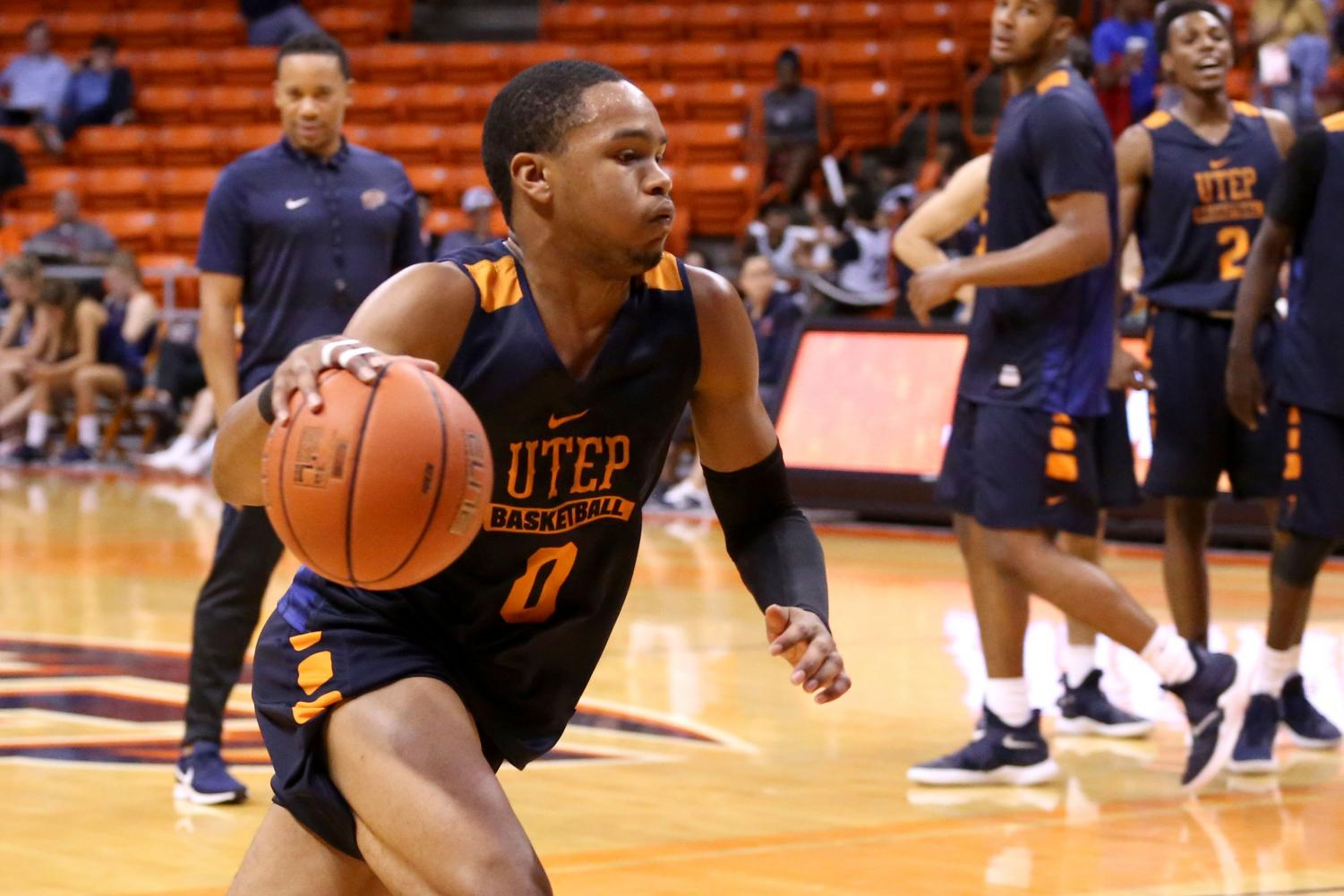 Freshman+guard+Nigal+Hawkins+drives+to+the+hole++during+the+basketball+pre+season+showcase+at+the+Don+Haskins+Center+on+Wednesday%2C+Oct.+10.+