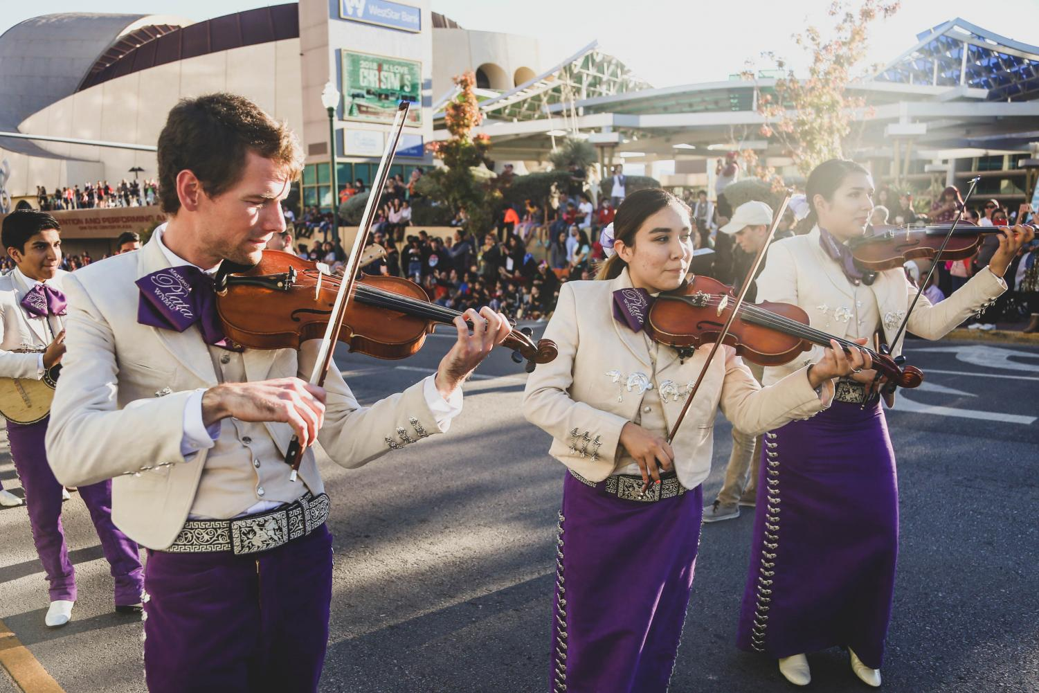 Mariachis+plays+their+instruments+as+they+walk+through+the+parade.+