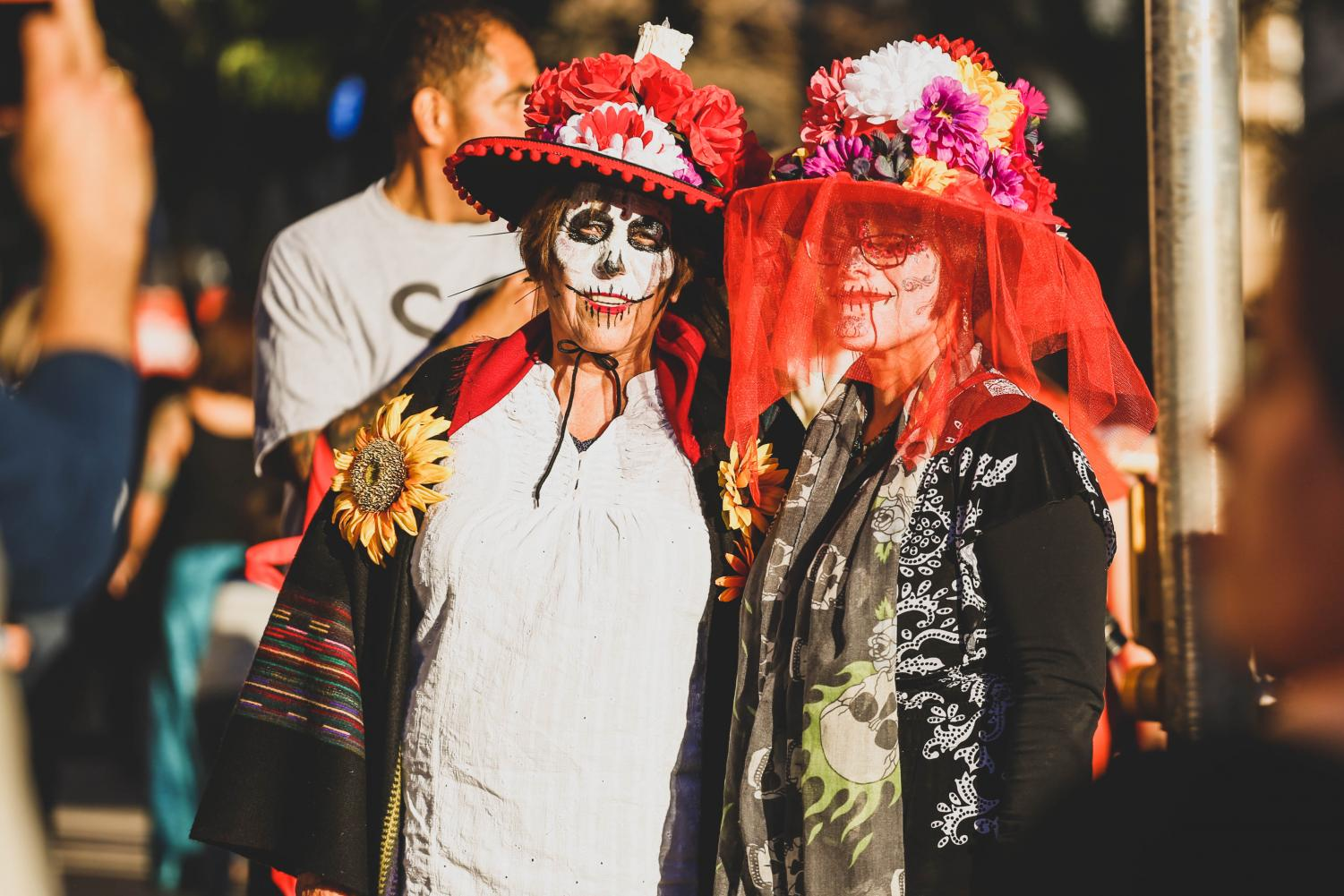 Attendees++dress+with+traditional+Mexican+clothings+and+paint+their+face+as+catrinas+to+celebrate+the+Day+of+the+Dead+on+Saturday%2C+Nov.+3+at+Down+Town+El+Paso.+
