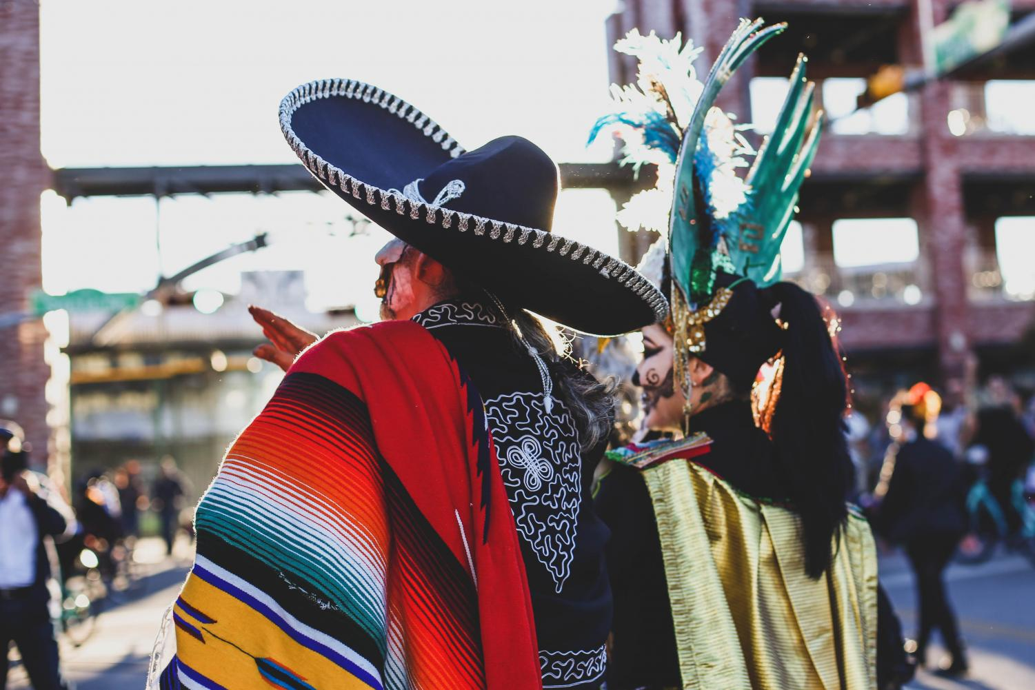 Attendees+dress+with+traditional+Mexican+clothings+and+paint+their+face+as+catrinas+to+celebrate+the+Day+of+the+Dead+on+Saturday%2C+Nov.+3+at+Down+Town+El+Paso.+