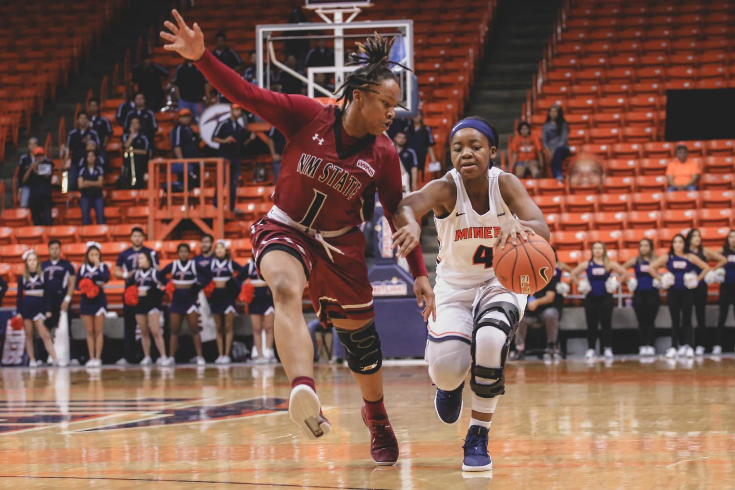 Junior+point+guard+Neidy+Ocuane+attempts+to+run+past+the+NMSU+defender.