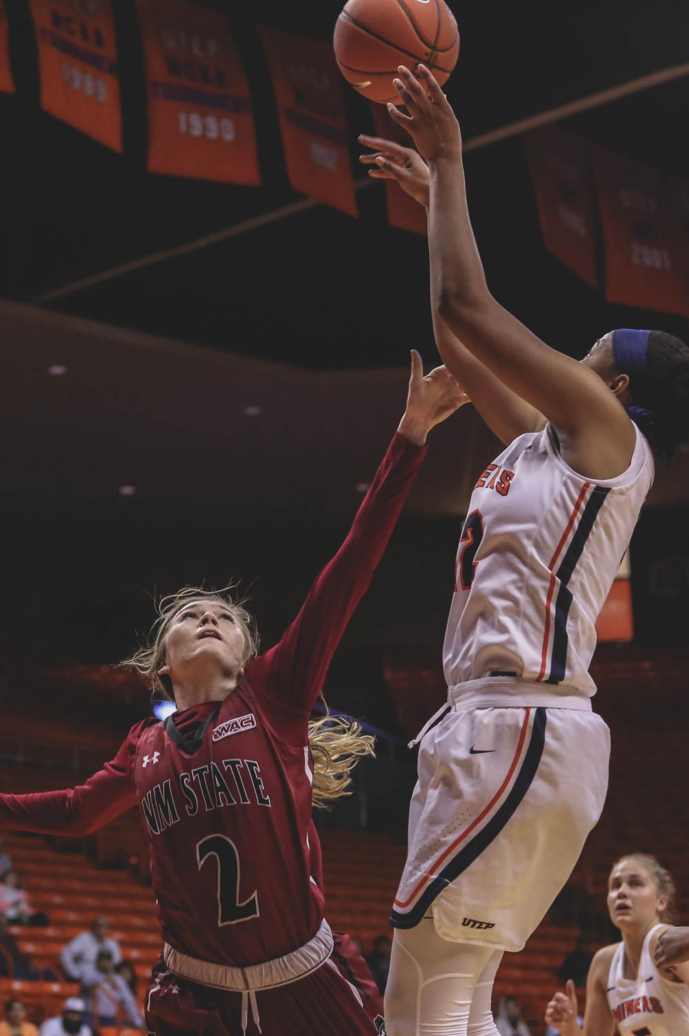 Junior+guard+Ariona+Gill+attempst+to+make+a+basket+over+the+NMSU+Aggies.+