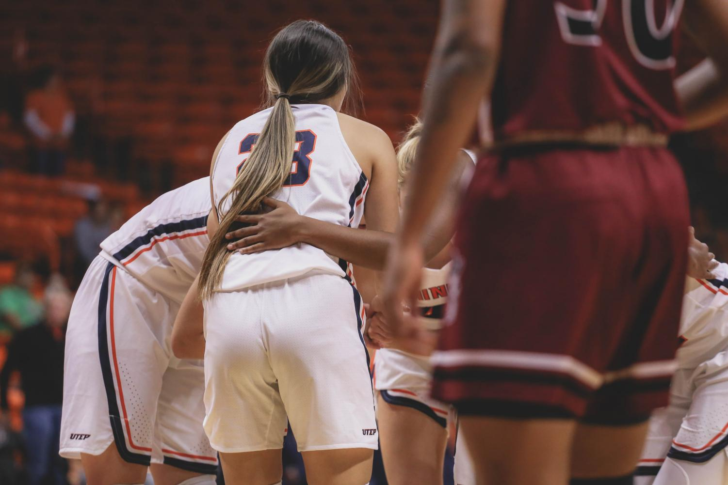 The+Lady+Miners+discuss+the+game+plan+during+a+media+time+out+at+a+game+against+the+NMSU+Aggies+on+Saturday%2C+Nov.+17.+