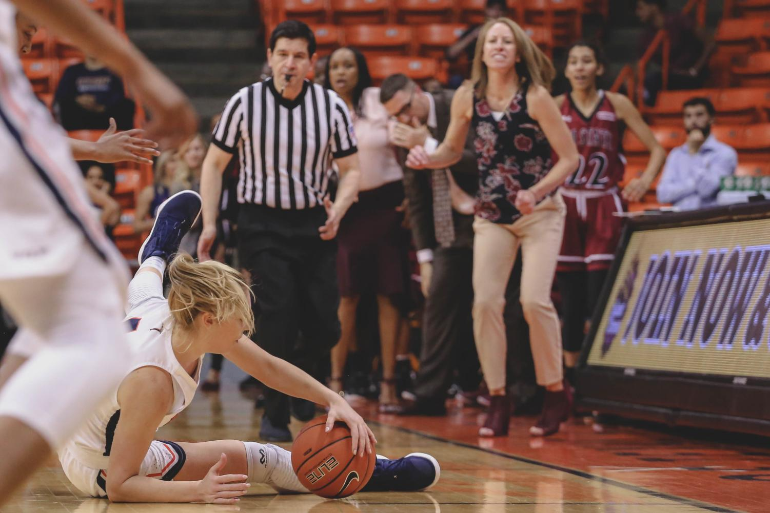 the+Aggies+celebrate+as+junior+guard+Katarina+Zec+trips+as+they+win+the+battle+of+I-10.