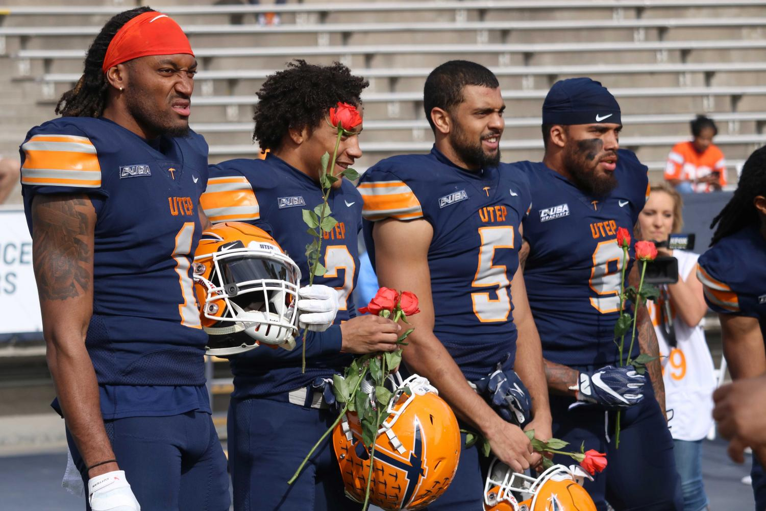Seniors+players+Nik+Needam%2C+Kalon+Beverly%2C+A.J+Hotchkins+and+Michael+Lewis+receive+roses+before+the+season+finale+on++Nov.+24%2C+2018.