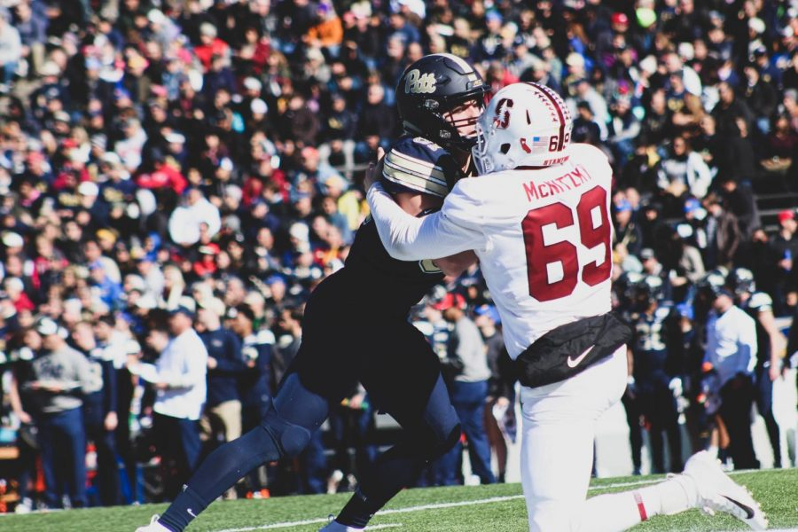 Stanford Junior Longsnapper Richard McNitzky battles against a Pitt defensive lineman Monday at the 85th annual Sun Bowl Game. Stanford defeated Pitt 14-13.