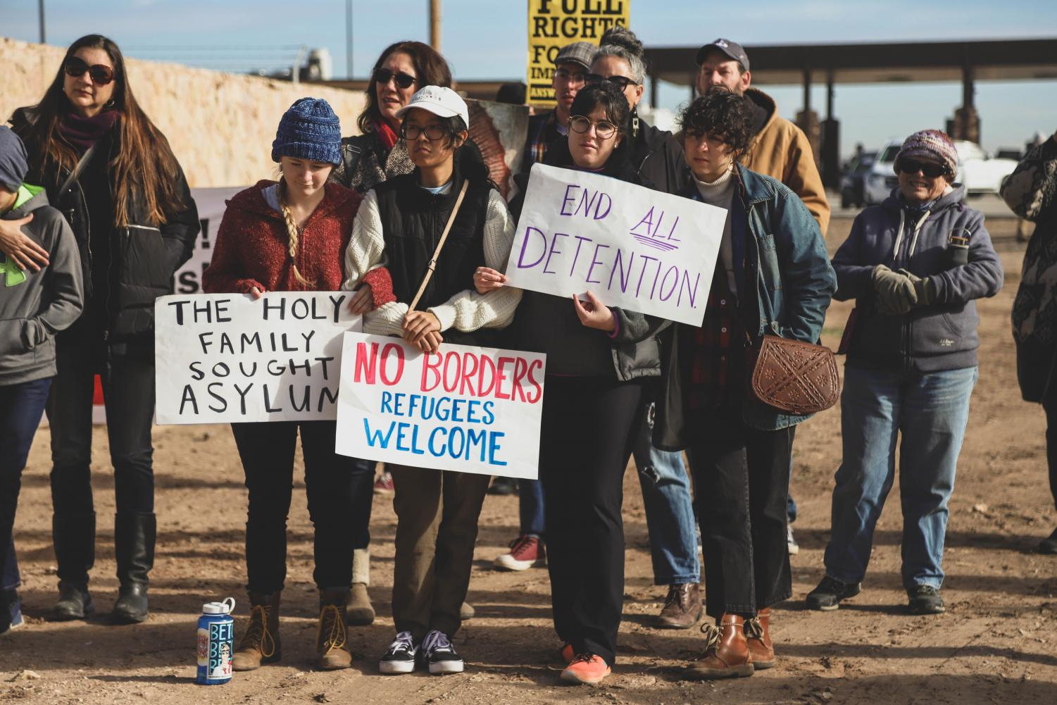 Demonstrators+hold+up+signs+to+protest+Tent+City+and+the+separation+of+families.