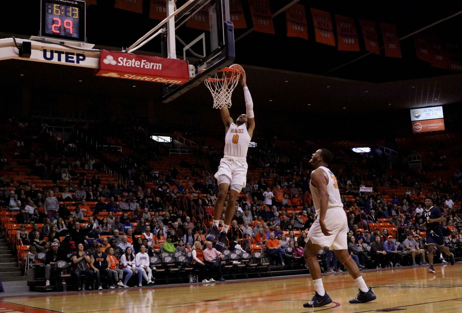 Freshman Nigel Hawkins dunks the ball on the fast break