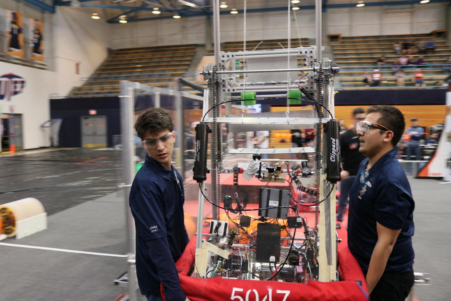 Competitors+take+their+robot+out+from+the+arena+in+Memorial+Gym+at+the+University+of+Texas+at+El+Paso%2C+Saturday%2C+March+2%2C+2019.