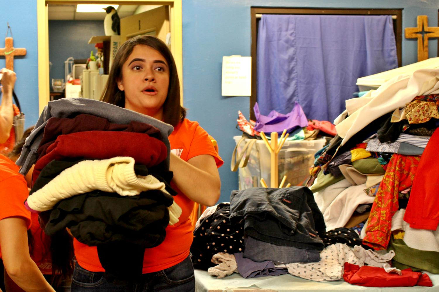 UTEP+Project+Move+help+sort+through+clothing+donations+at+Rescue+Mission+warehouse%2C+El+Paso.