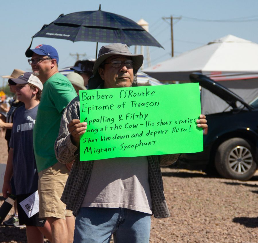 A man holds a sign listing controversial short stories and poems by Democratic presidential candidate Beto ORourke at the Clint Border Patrol Station rally held by ORourke on Sunday June 30, 2019.