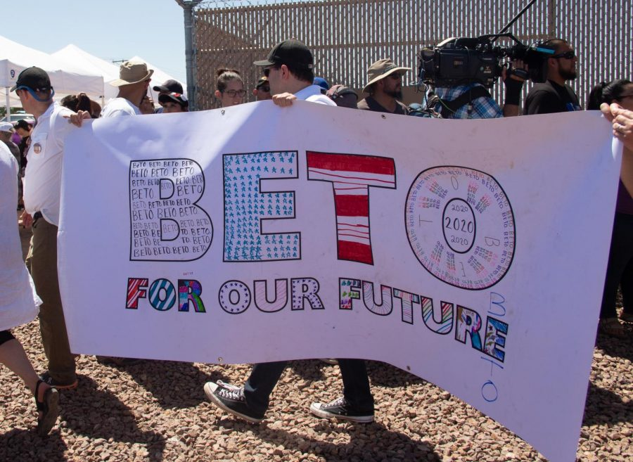 Three+people+hold+a+%22Beto+2020%22+sing+at+the+Clint+Border+Patrol+Station+rally+held+by+Democratic+presidential+candidate+Beto+O%27Rourke+on+Sunday+June+30%2C+2019.