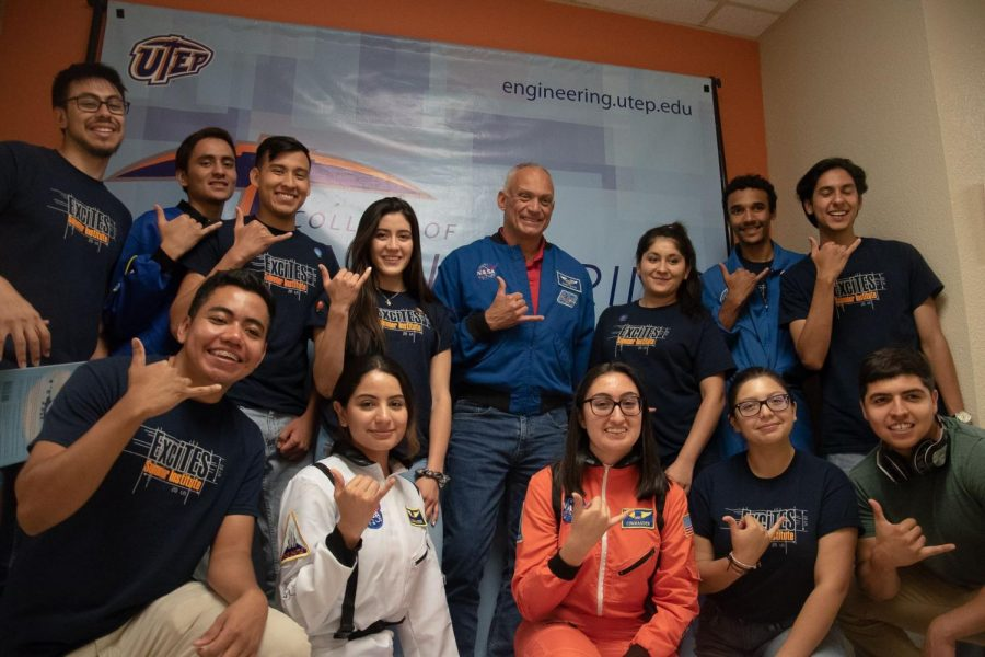 College+of+Engineering+Excites+Team+holds+their+picks+up+with+retired+astronaut+and+UTEP+Alumni+John+D.+Olivas+at+the+50th+anniversary+of+the+Apollo+11+Moon+Landing+celebration+at+UTEP.