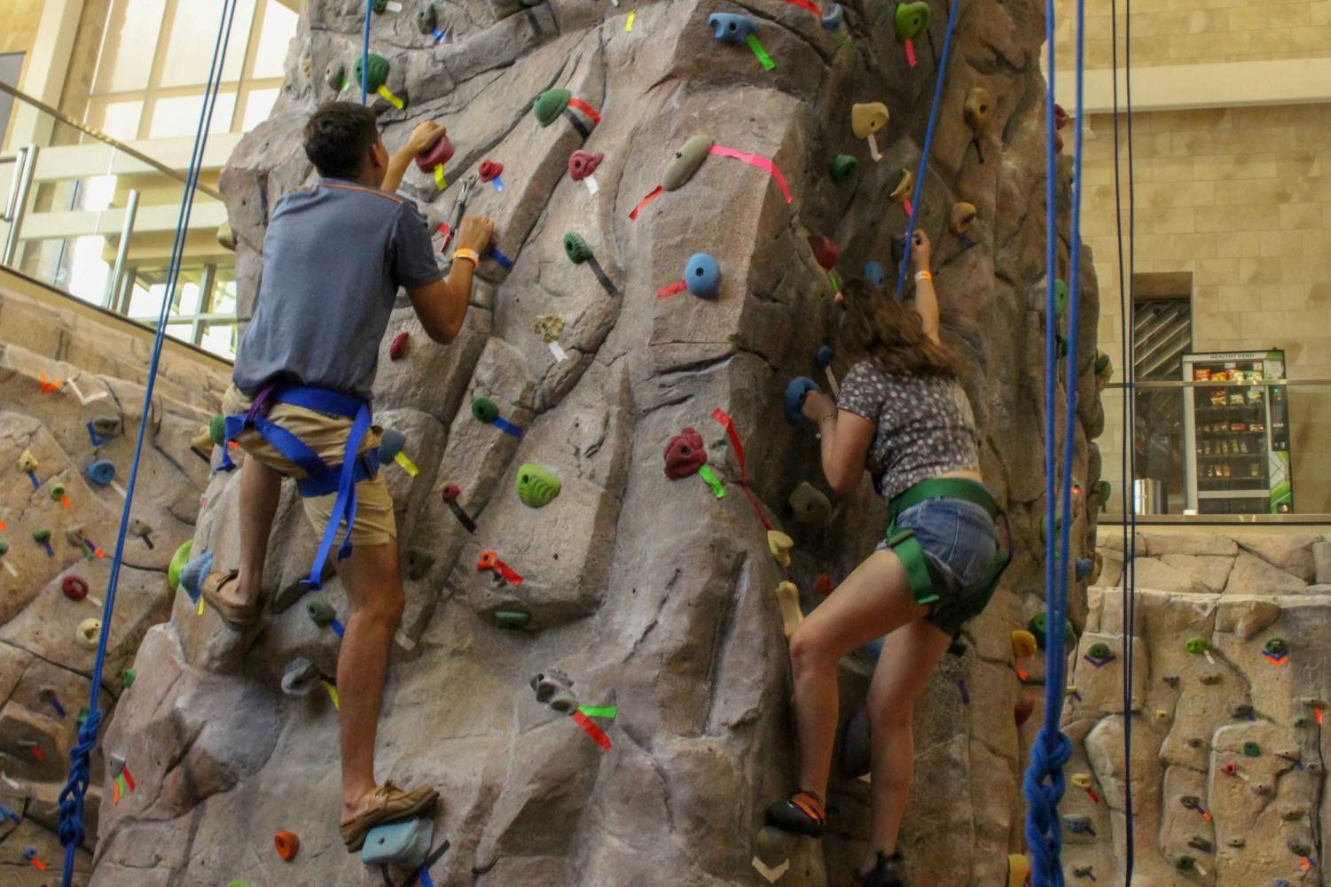Students climb a rock wall at the 4th annual Miner Melt