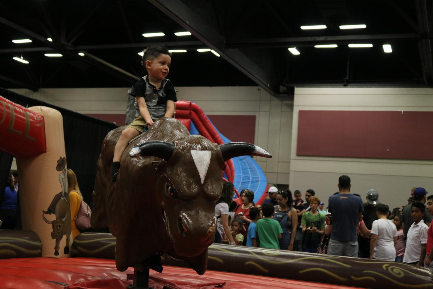 Kid+rides+a+mechanic+bull+during+the+Ice+Cream+Festival+in+El+Paso+Convention+Center+on+Sunday%2C+June+20%2C+2019.+During+the+event%2C+kids+had+fun+through+different+activities+and+attractions.