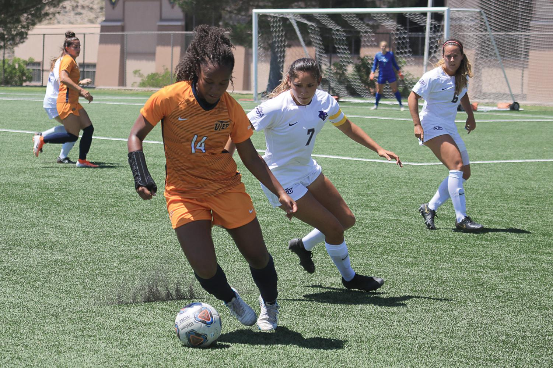 Defender Kori Lewis fights the ball against Abilene Christian University Sunday Aug. 24.