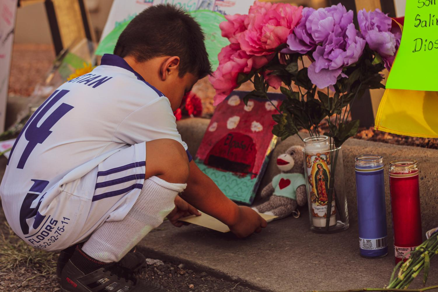 Families come together at vigil outside of Cielo Vista Walmart, Monday August 6th.